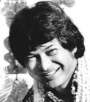 Black and white picture of Hawaiian Singer Don Ho smiling.